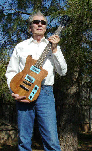 Sonny_West_with_guitar_he_made_from_Texas_Mesquite_wood
